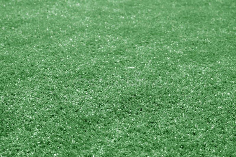 与迷离作用的人为草橄榄球场贷款在绿色口气 图库摄影