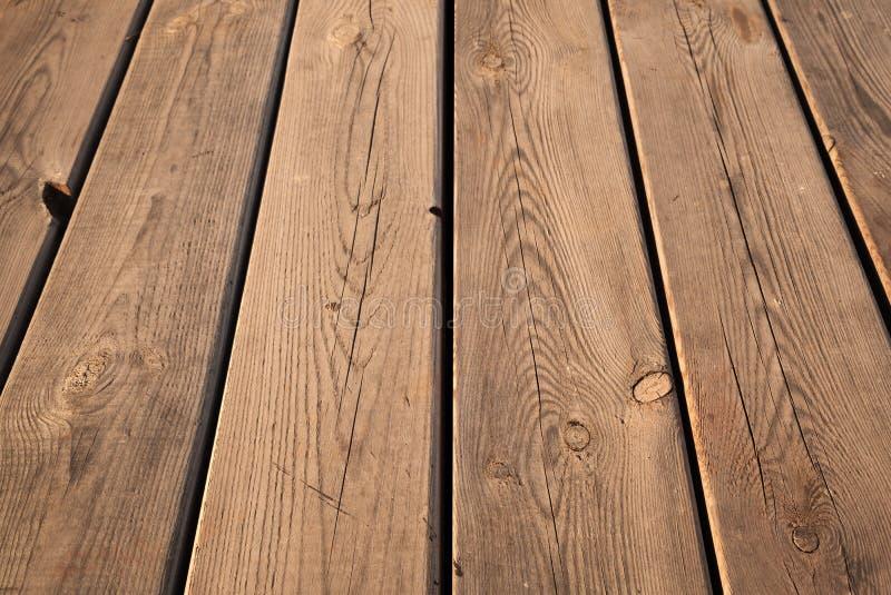 与透视的布朗木桌背景纹理 免版税库存图片