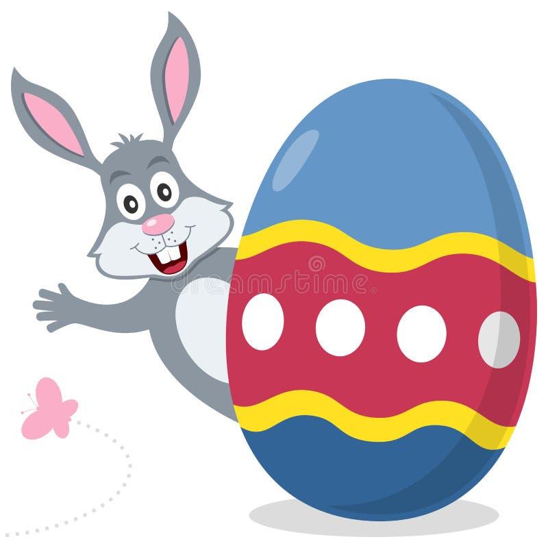 与逗人喜爱的兔宝宝的复活节彩蛋 皇族释放例证