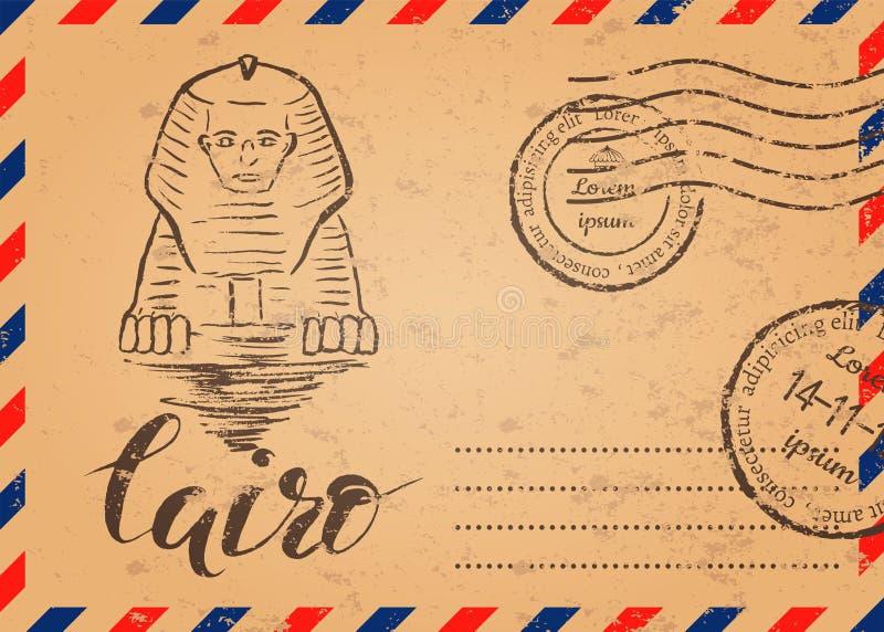 与邮票的减速火箭的信封,与手拉的狮身人面象的开罗标签,在开罗上写字 库存图片