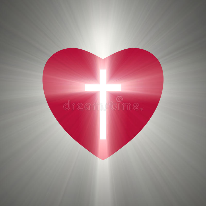 与里面一个光亮的十字架的心脏形状 皇族释放例证