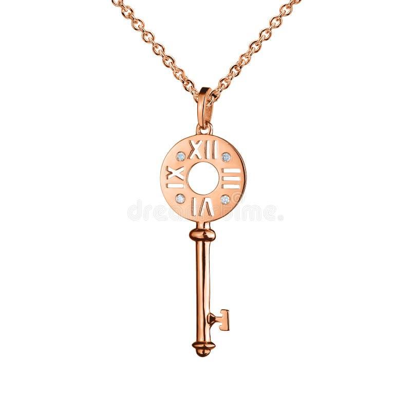 与金刚石的首饰金黄垂饰,与手表标记的钥匙,金黄链子,玫瑰色金子,隔绝在白色 库存图片