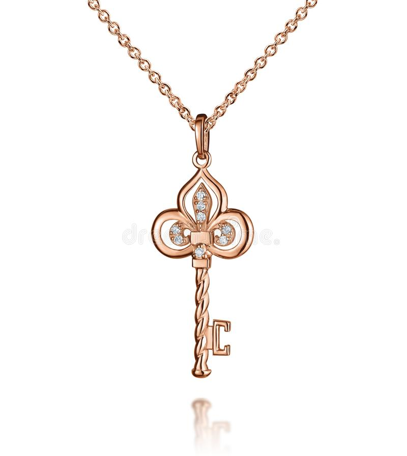 与金刚石的首饰金黄垂饰,钥匙,金黄链子,玫瑰色金子,隔绝在白色 库存图片