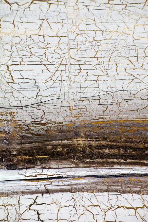 与金子、油漆镇压和条纹的背景在减速火箭的样式的 免版税库存照片