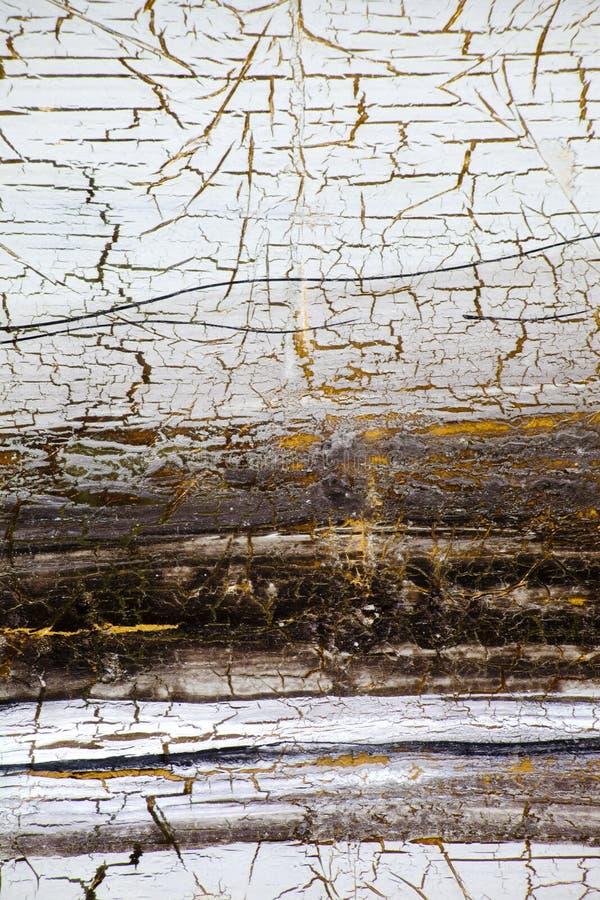 与金子、油漆镇压和条纹的背景在减速火箭的样式的 免版税库存图片