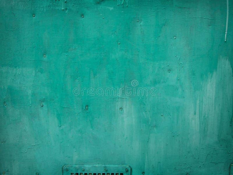 与金属细节的浅绿色的被绘的木背景 库存图片
