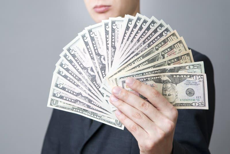 与金钱的商人在演播室 免版税库存照片