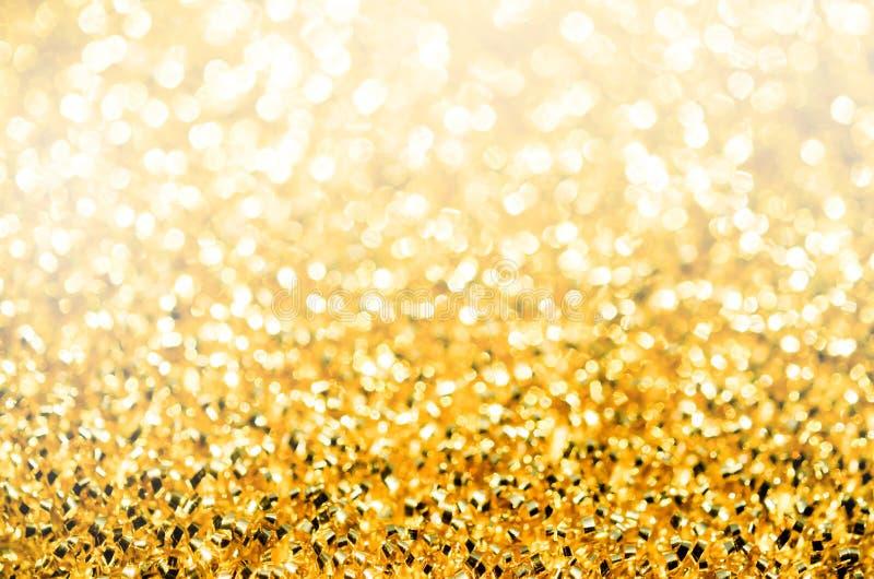 与金黄闪光的抽象背景 库存图片