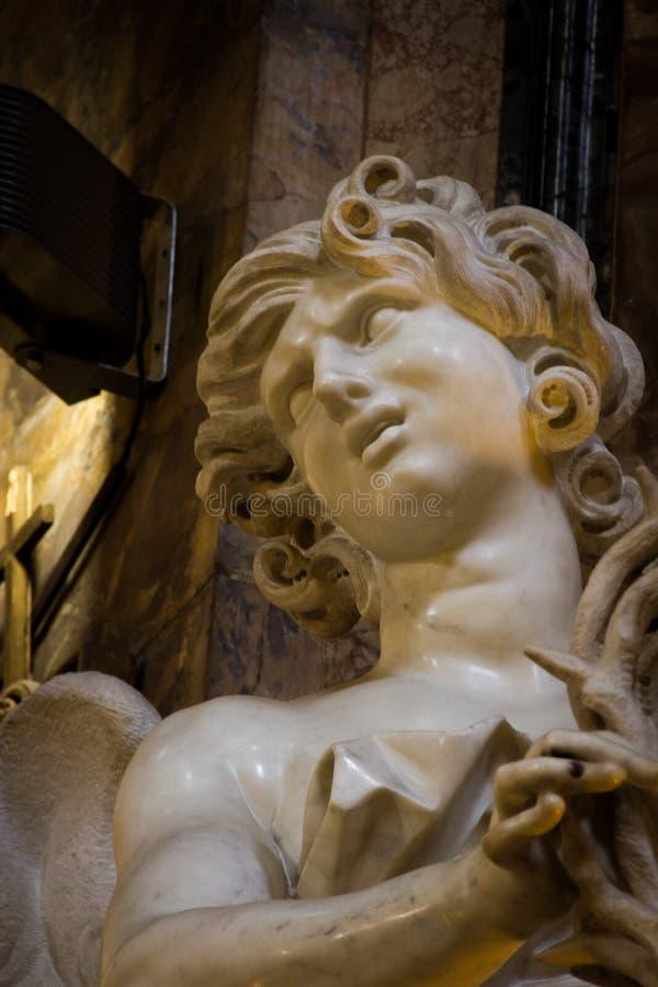 与铁海棠的天使 免版税图库摄影
