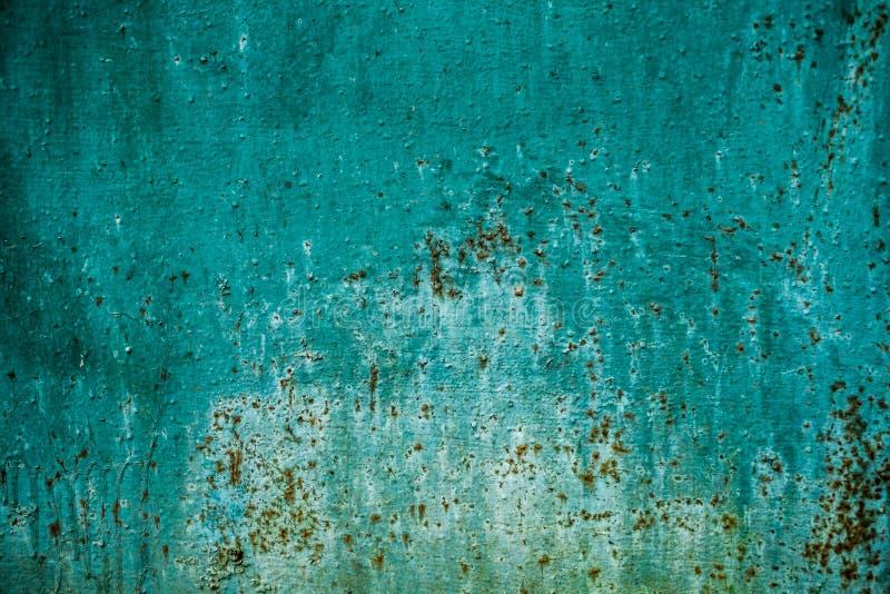 与铁锈的绿色墙壁纹理背景 免版税库存照片