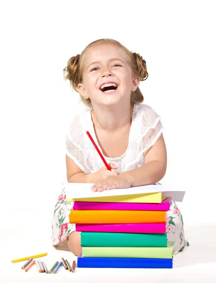 与铅笔的小女孩图画 库存照片