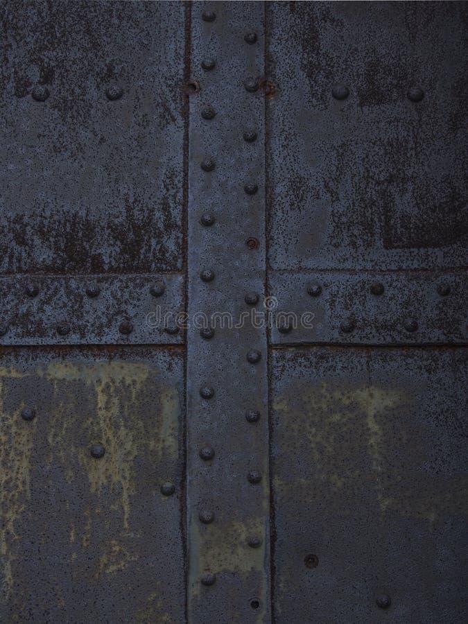 与铆钉的生锈的金属纹理 免版税库存图片