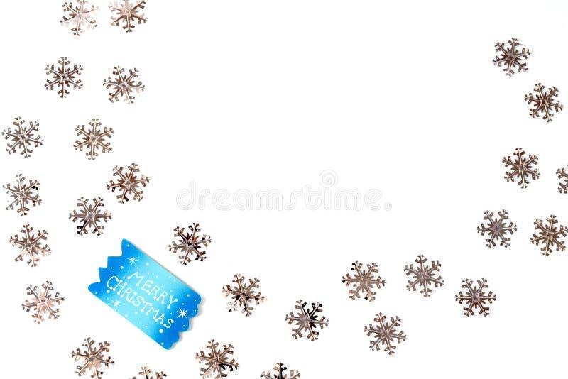 与银色雪花的圣诞节背景 免版税库存照片