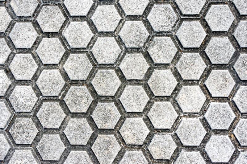 与铺路石和六角形形状的地板 库存图片