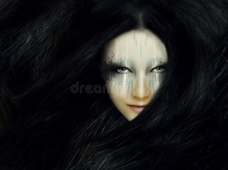 与长的头发的妇女画象 图库摄影