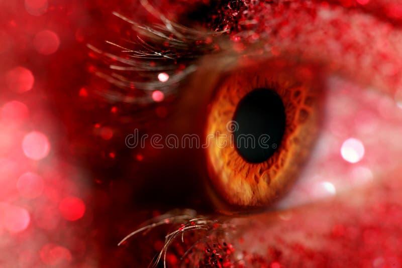 与闪耀的红色闪烁的眼睛 库存图片