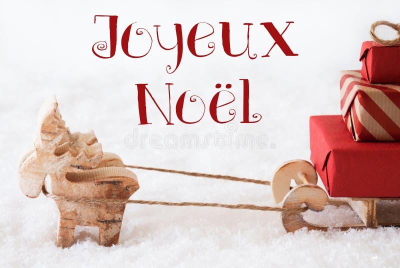 与雪撬的驯鹿在雪,茹瓦约Noel意味圣诞快乐 库存照片