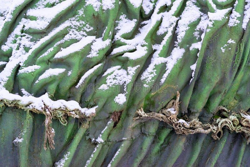 与雪的抽象参差不齐的纹理 图库摄影