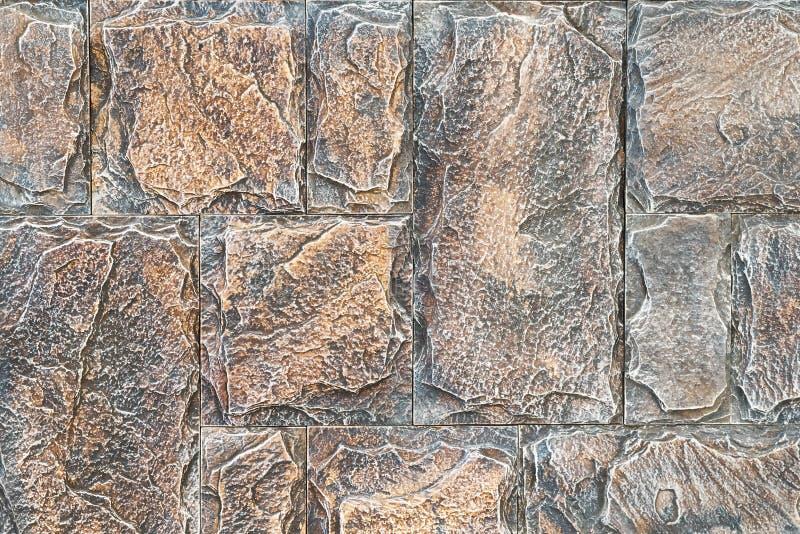 与非对称的石制品 特写镜头明亮的葡萄酒砖墙背景 背景纹理的石墙 免版税库存照片