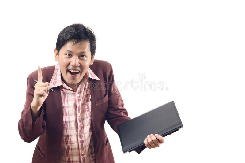 与面孔手指前面的亚洲商人和在白色同意 免版税库存图片