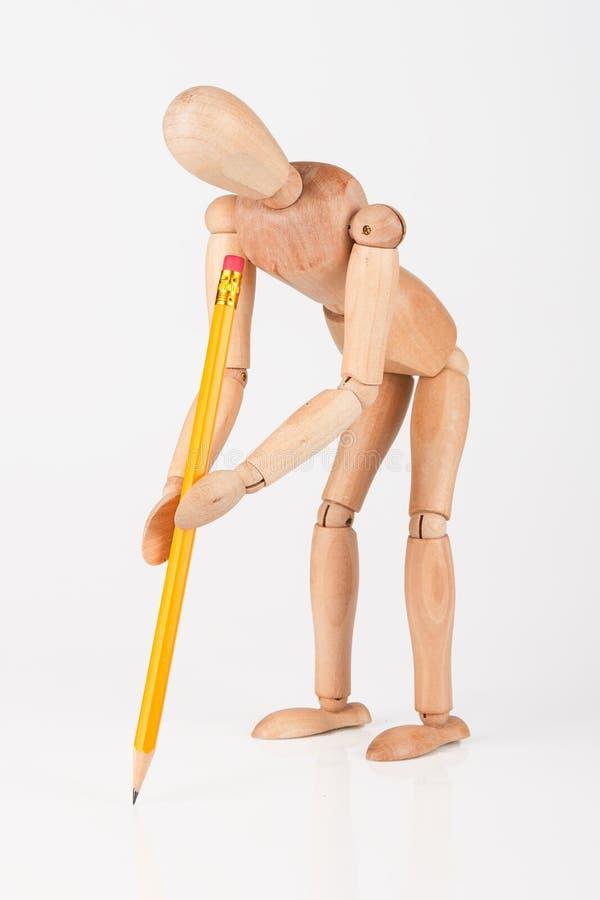 与颜色铅笔o的小木时装模特立场文字 库存图片