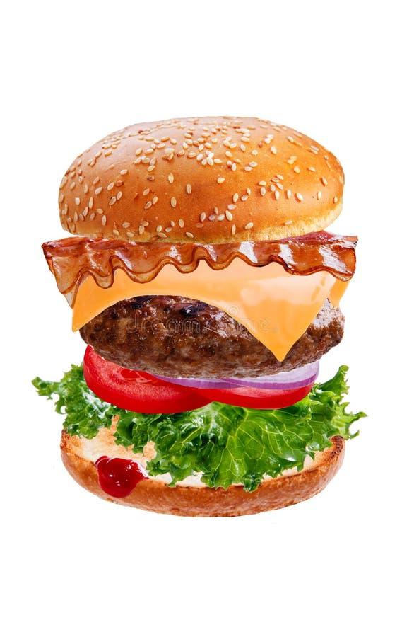 与飞行落的成份的汉堡包汉堡在白色背景 库存照片