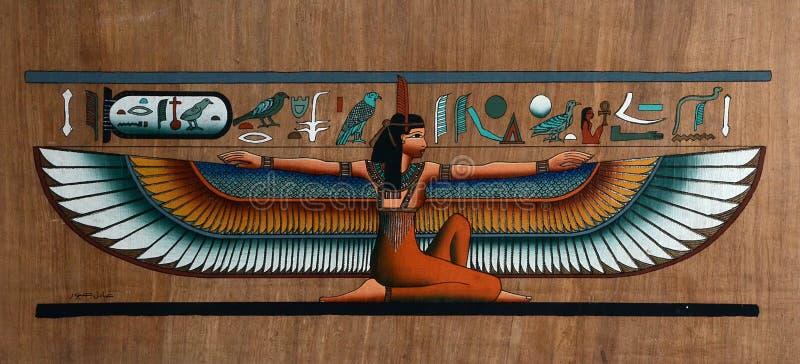 与飞过的女神的埃及纸莎草 图库摄影