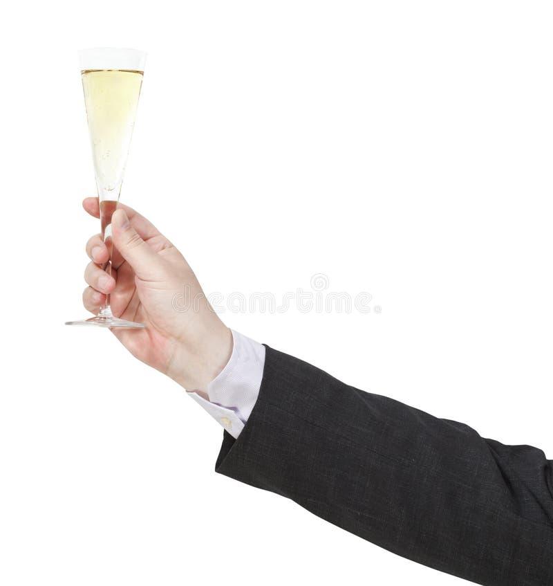 与香槟玻璃的多士在商人手上 库存图片