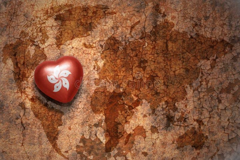 与香港国旗的心脏葡萄酒世界地图裂缝纸背景的 库存图片