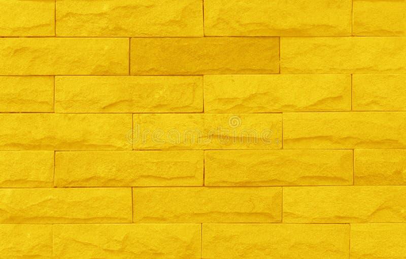 与高分辨率的黄色砖墙纹理背景和设计书刊上的图片的 免版税库存图片