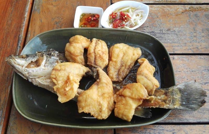 与鱼子酱Pla托德数字pla的油煎的鱼 库存图片