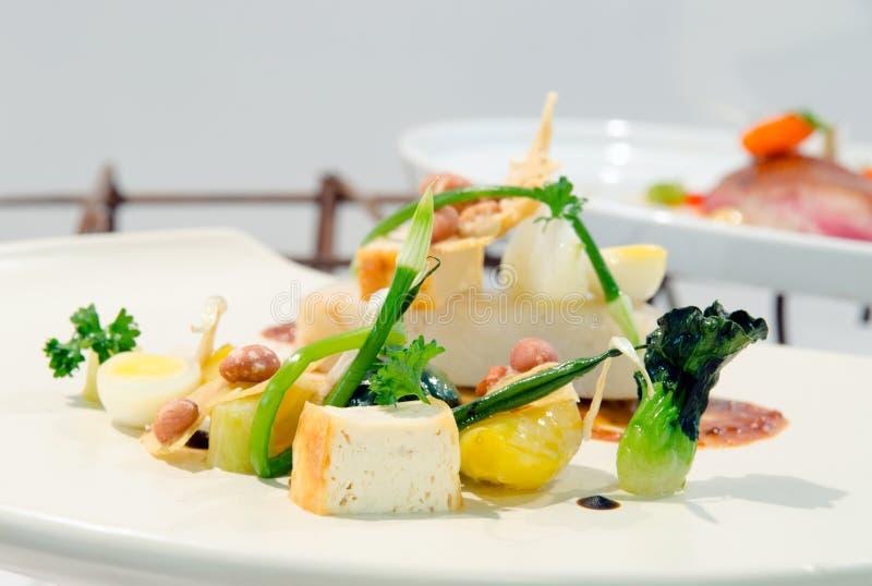 与鱼的素食混合 免版税库存照片