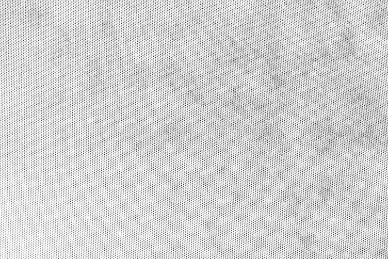 与黑小点的纹理抽象灰色白的背景 免版税库存图片