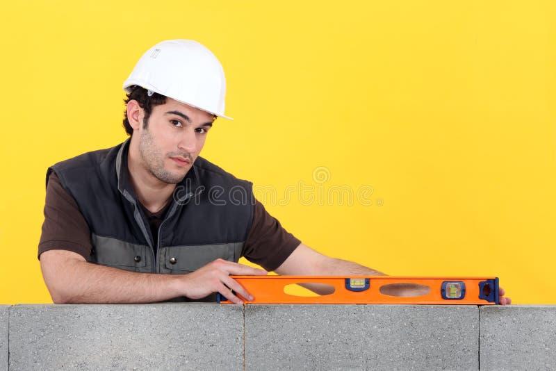 与水平仪的建造者 免版税库存照片