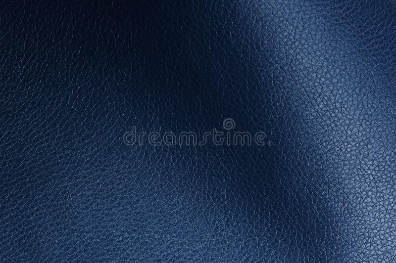 与阴影的深蓝人造革纹理 免版税图库摄影