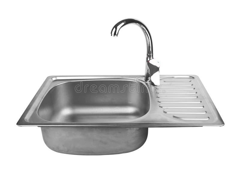 与轻拍的厨房水槽 免版税库存照片