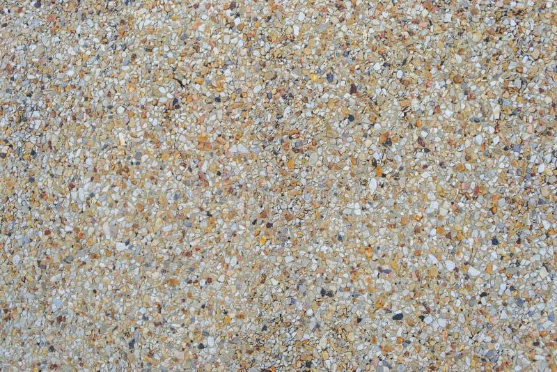 与水泥地板纹理的沙子 库存照片