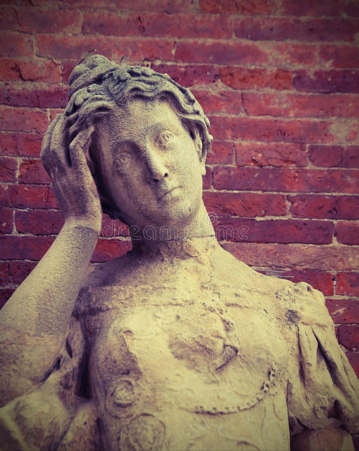 与头疼的雕象 免版税图库摄影