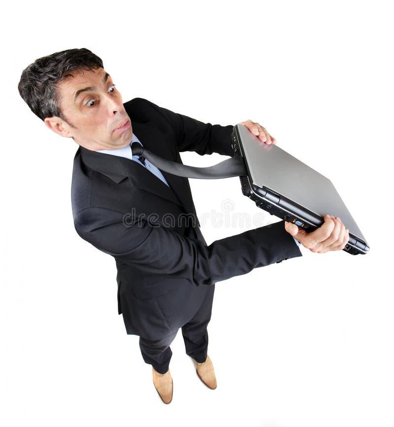 与他的被捉住的领带的商人 库存图片