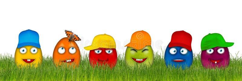 与滑稽的面孔的五颜六色的复活节彩蛋 免版税库存图片