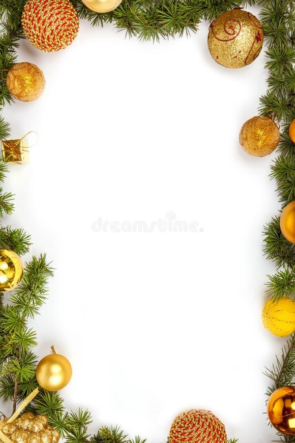 与黄色装饰物的圣诞节装饰 免版税库存照片