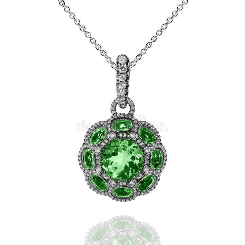 与绿色绿宝石和白色金刚石的人造白金垂饰 免版税图库摄影