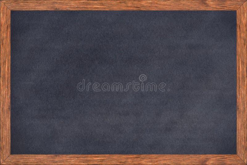 与黑表面的黑板木框架 库存图片