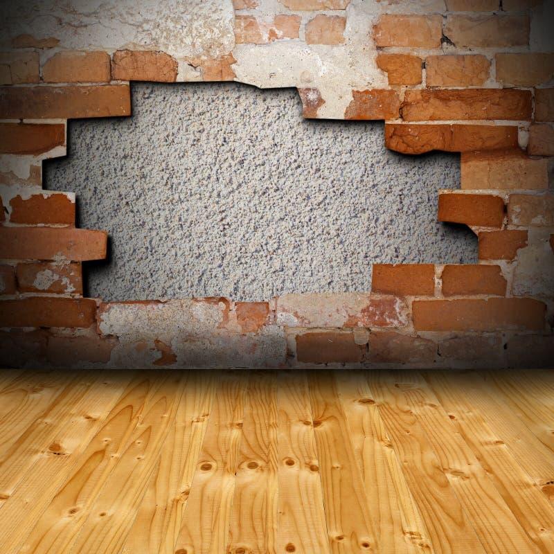 与破裂的墙壁的内部背景 库存照片