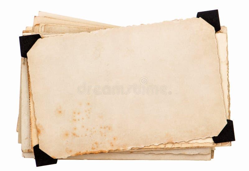 与黑角落的照片卡片。老脏的纸板料 免版税库存照片