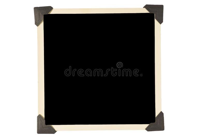 与黑角落的老方形的照片框架 库存照片