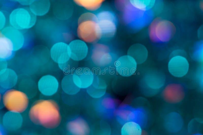 与bokeh的五颜六色的闪烁摘要背景 免版税库存照片