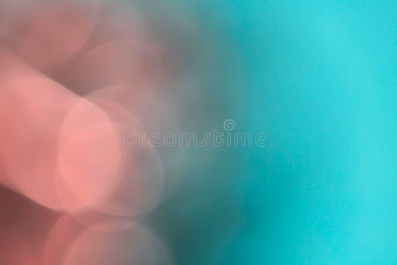 与bokeh的抽象模糊的桃红色和蓝色背景 库存照片