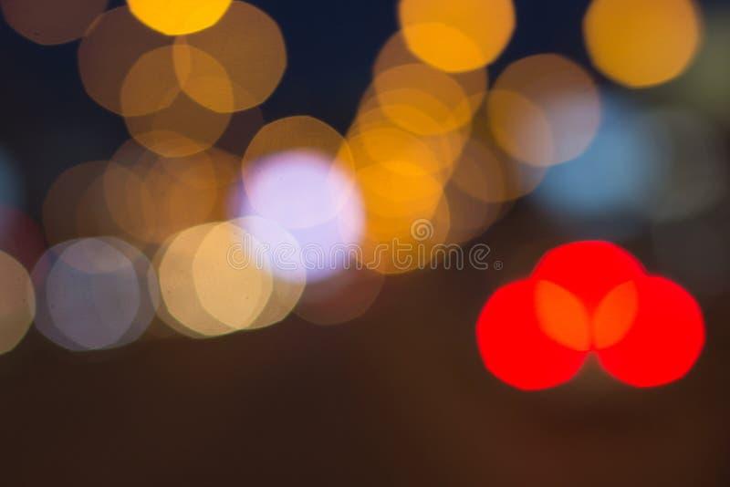 与bokeh的被弄脏的光影响背景,抽象迷离 免版税库存照片