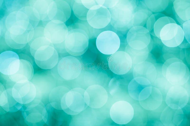 与bokeh defocused光的蓝色,绿色和绿松石背景 图库摄影